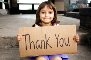 Little Girl Holding A Thank You Sign